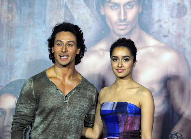 Indian Bollywood actors Tiger Shroff (L) and Shraddha Kapoor attend the trailer launch of the upcoming Hindi film 'Baaghi' in Mumbai on March 14, 2016. / AFP