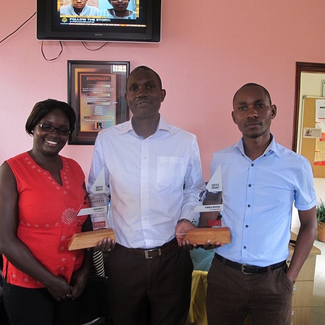 Musoke (RIGHT) is Uganda's best. Here he hands Managing Editor Joseph Were a trophy last year.