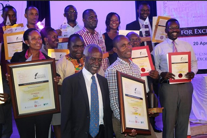 Ronald Musoke of the Independent (overall winner of ACME awards) with Chief Guest Justice James Ogoola and other winners