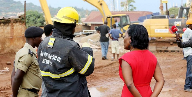 KCCA's Musisi being briefed by the rescue teams. Little home remains for any other survivors. PHOTOS BY KCCA