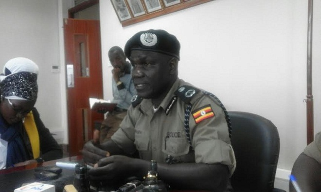 Policeman Mugisa briefs press on floods and goons situation. PHOTO BY CHARLOTTE NINSIIMA