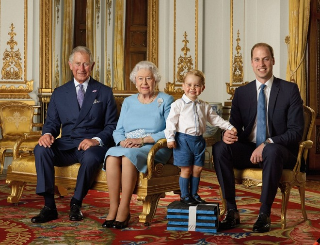 A handout image released shows (L-R) Britain's Prince Charles, Prince of Wales, Britain's Queen Elizabeth II, Britain's Prince George, and Britain's Prince William, Duke of Cambridge smiling during a photo shoot for the Royal Mail in 2015 in the White Drawing Room at Buckingham in London.