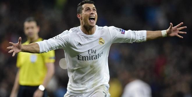 Real Madrid's Portuguese forward Cristiano Ronaldo celebrates after scoring his third goal  April 12, 2016. / AFP