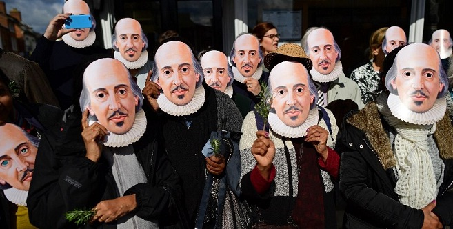 "Wearing masks of the ""Bard of Avon"", members of the public prepare for the parade marking 400 years since the death of William Shakespeare, in Stratford-upon-Avon on April 23, 2016/ AFP"