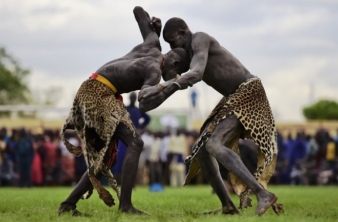 Wrestlers from Jonglei and eastern lakes region take part in the South Sudan National Wrestling Competition for peace at Juba Stadium, South Sudan, on April 20, 2016. AFP PHOTO