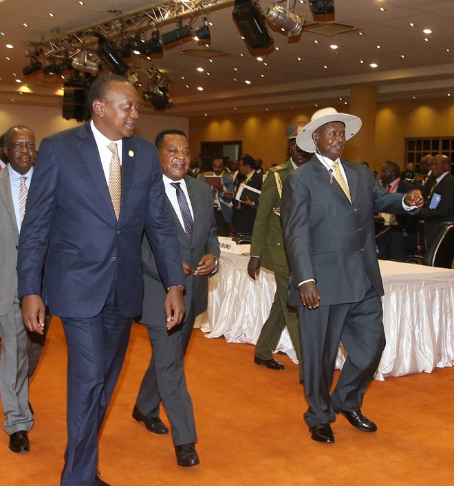 Museveni welcomes Kenyatta to the summit. Kenya and Tanzania left the summit happy.
