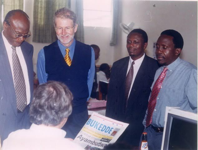 William Pike and Bukedde editors discuss with newspaper designer David Billington from London. Pike focused on the itty-bitty teeny-tiny things.