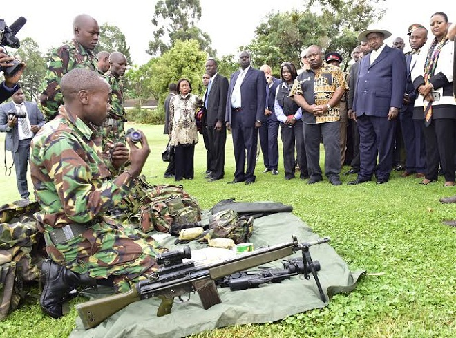 Museveni and Ali Bongo of Gabon being shown how Game Rangers work during the Giants Summit in Nairobi yesterday.