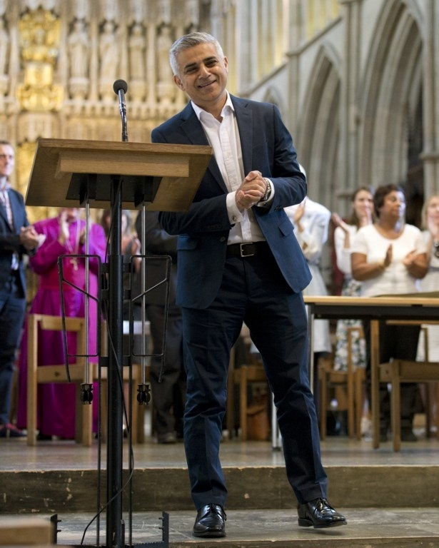 Britain's incoming London Mayor Sadiq Khan reacts during his swearing-in ceremony at Southwark Cathedral in cental London on May 7, 2016. PHOTO AFP