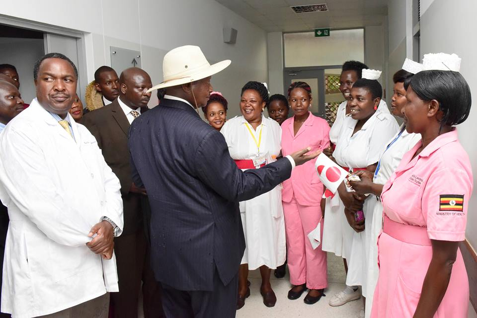 Museveni talking delivery of services with nurses on a visit this week.