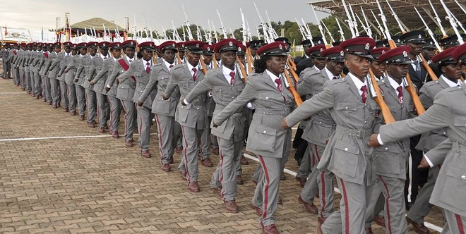 Prisons officers march during the recent Presidential Inauguration at Kololo. President Museveni has promoted 149 of them
