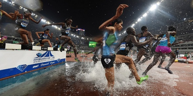Athletes compete in the women's 3000m Steeplechase at the Shanghai Diamond League athletics competition in Shanghai on May 14, 2016. / AFP PHOTO