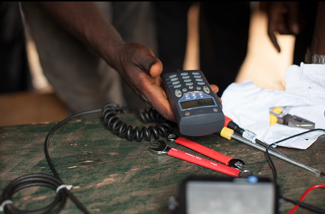 A technician sets up a phone radio in Centra Africa Republic. PHOTO BY INVISIBLE CHILDREN