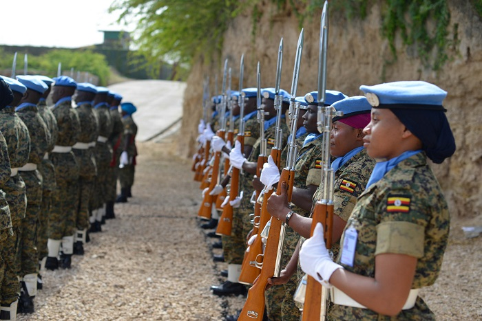 Officers and men of the United Nations Guard Unit from the UPDF mount a guard of honour during a medal awards ceremony held in Mogadishu, Somalia on June 26, 2016. ALL AMISOM PHOTOS/Omar Abdisalan