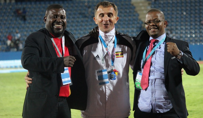 Cranes officials, team leader Dennis Mbidde, coach Micho and FUFA president Magogo celebrate in Botswana. PHOTO BY FUFA