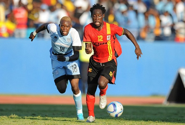 Uganda's defender Denis Iguma (R) evades Botswana's midfielder Lebogang Ditsile during the AFCON 2017 qualifying match Botswana vs Uganda at the Francistown stadium in Botswana on June 4, 2016. AFP PHOTO