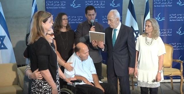 Peres with veterans of the Entebbe Raid earlier this year.