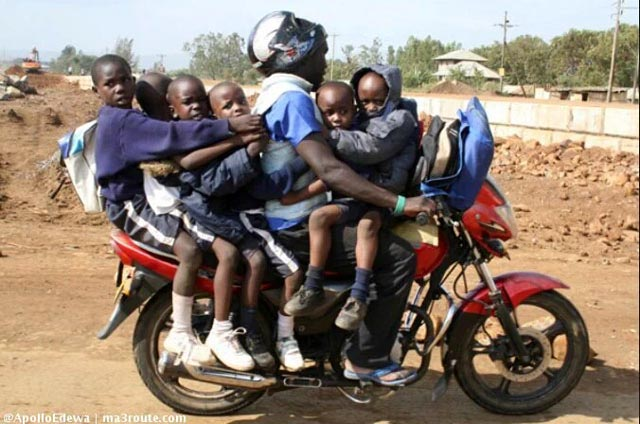 A man carries six schoolchildren on a bodaboda