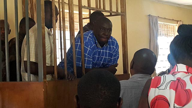 Kabaziguruka with his co-accused in the dock at the Army Court in Makindye. Photo via @Snduhukire