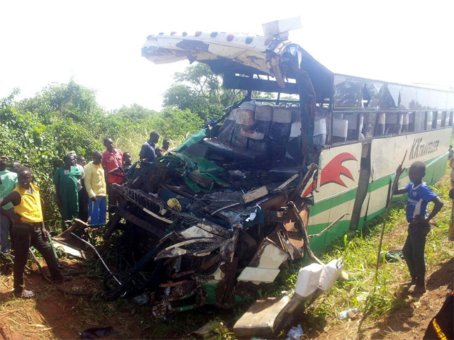 Residents look at the wreckage of the bus after it hit an elephant