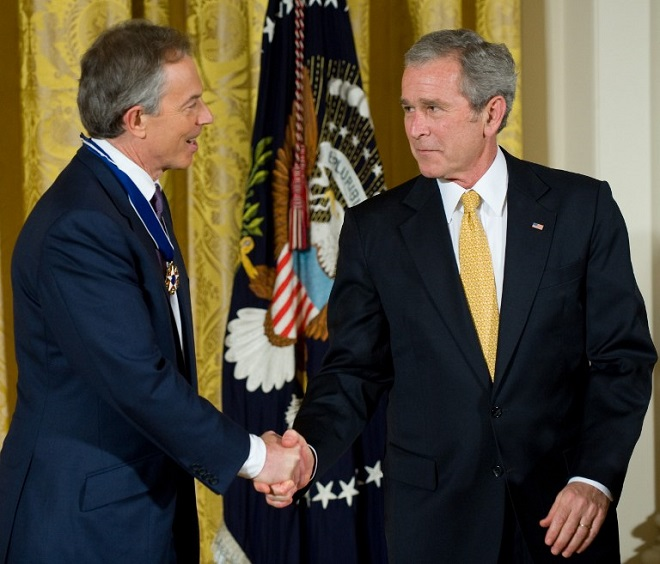 (FILES) This file photo taken on January 12, 2009 shows US President George W. Bush presenting the Presidential Medal of Freedom to former British Prime Minister Tony Blair at the White House in Washington, DC. PHOTO AFP