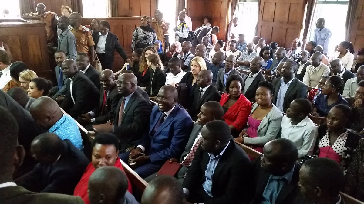 The scene in court as Besigye was brought in for his treason case hearing. PHOTO VIA @MICOH