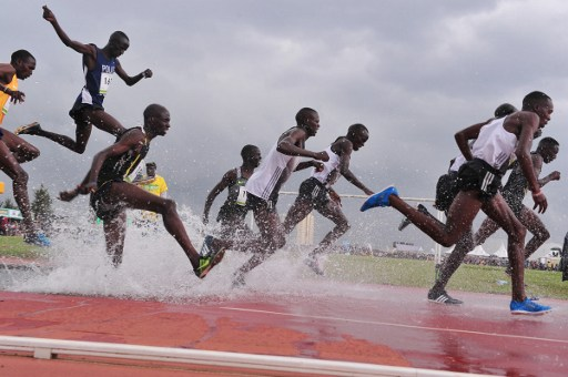Kenyan double Olympic champion and three-time world champion Ezekiel Kemboi (2nd L) competes in the 3000m steeplechase in Eldoret on July 1, 2016, during the trials for Rio Olympic Games. / AFP PHOTO / SIMON MAINA