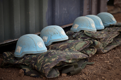 Blue helmets and uniforms of members of the Dutch Engineering Company serving with the UN Multidimensional Integrated Stabilization Mission in Mali (MINUSMA) are seen neatly lined up on the ground at the military camp under construction in Gao.