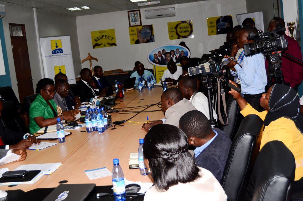 Doris Akol shares URA revenue figures with the press. PHOTO URA
