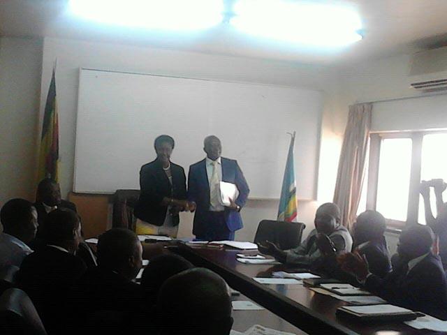 Minister Amelia Kyambadde hands over to state minister of cooperatives Ngobi Ggume. Photo by Charlotte Ninsiima