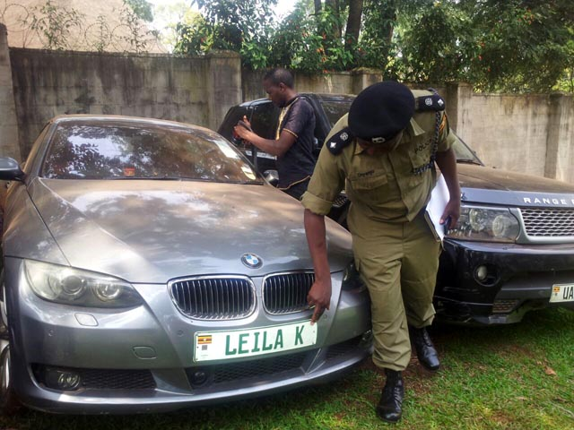 A police officer inspects Kayondo;s car at Interpol headquarters