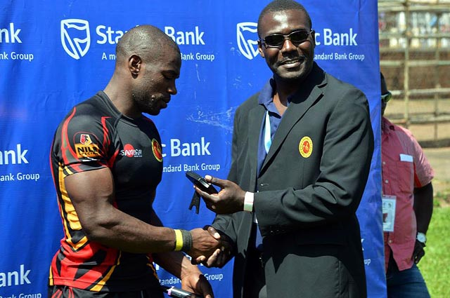 Ssebuliba is handed man of the match gong by URU boss Andrew Owor last year after he terrorised Mauritius in the Rugby Afrique Tier 1B tournament in Kampala