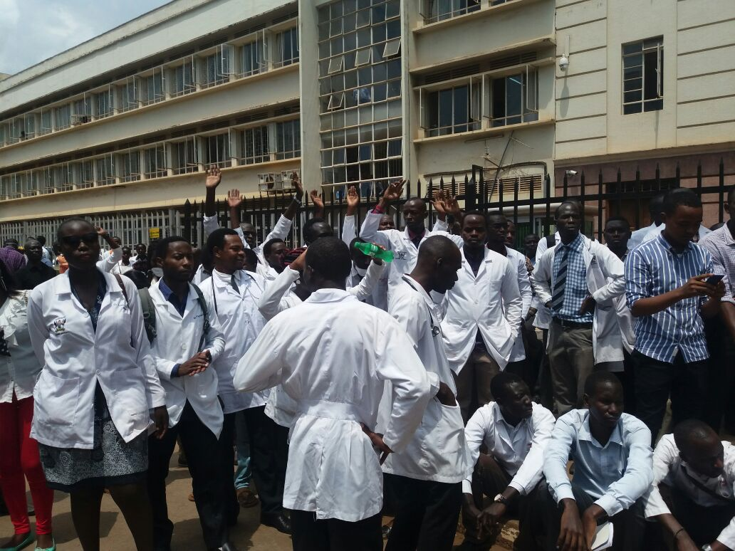 Interns outside parliament. They were stopped from moving in. PHOTOS GODFREY SSAILI