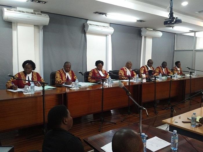 Justice Jotham Tumwesigye (centre) reads the full judgment today. COURTESY PHOHTO