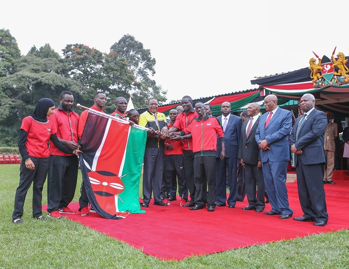 Kenyatta sends off the Olympics team. A kit scandal has hit the team after the games.