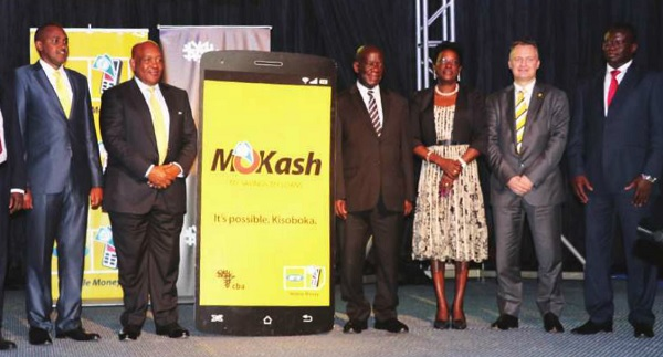 (L-R ) ICT Minister Frank Tumwebaze, MTN Uganda Chairman Charles Mbire, and the Vice President Edward Sekandi. Others are BOU''s Justine Bagyenda, MTN CEO Wim Vanhelleputte and CBA CEO Samuel Odeke during the launch of MTN'S MoKash on Aug 09. Courtesy photo