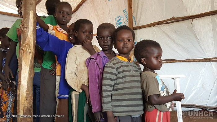 Youngest first! Children, refugees from #SouthSudan, line up patiently for medical examinations in Koluba Transit Centre Uganda, after which they will be relocated to Yumbe. PHOTO UNHCR