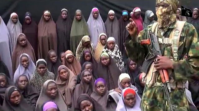 FILE PHOTO: Some of the Chibok girls under guard by rebels