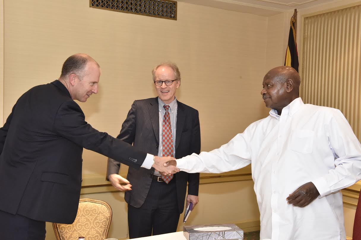 vIRIAN vice President Whitman (centre) introduces a comany official when he met President Museveni. PHOTO PPU