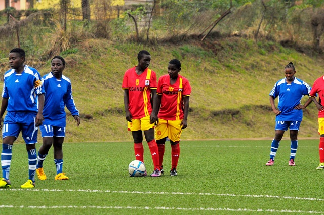 Crested Cranes players prepare for a free-kick against Zanzibar. They today qualified for the semifinals with another win. PHOTO FUFA MEDIA