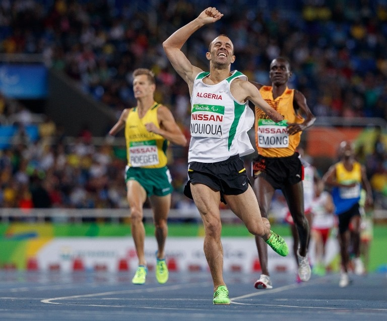 Samir Nouioua of Algeria wins the gold medal in the men's 1500m - T46 final in the Olympic Stadium during the Paralympic Games in Rio de Janeiro, Brazil on September 16, 2016. Photo by Simon Bruty/OIS/IOC via AFP. RESTRICTED TO EDITORIAL USE. / AFP PHOTO / Simon Bruty for OIS