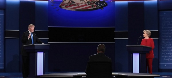HEMPSTEAD, NY - SEPTEMBER 26: Republican presidential nominee Donald Trump (L) speaks as Democratic presidential nominee Hillary Clinton and Moderator Lester Holt listen during the Presidential Debate at Hofstra University on September 26, 2016 in Hempstead, New York. The first of four debates for the 2016 Election, three Presidential and one Vice Presidential, is moderated by NBC's Lester Holt. Drew Angerer/Getty Images/AFP
