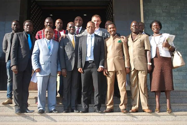 FUFA president Moses Magogo (centre) flanked by MP Obua and Ssewanyana, coach Micho and other FUFA officials and MPs at parliament on Tuesday.