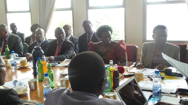 Dr.Jane Ruth Aceng and Sarah Opendi Achieng face the Health Committee chaired by  Bukuya Mp Dr.Michael Yiga Bukenya. PHOTO GODFREY SSALI