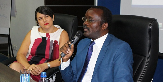 "NWSC Dr. Mugisha talks at the Customer Connect session as one ""water heroe"" Nada Andersen looks on. PHOTOS NWSC"