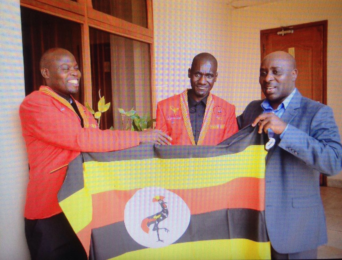 NCS Gen Sec Nicholas Muramagi (right) sees off Uganda's Paralympic team early this month.
