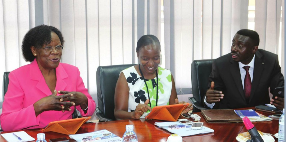 UEGCL chairman Stephen Isabalija shares alight moment with board members Zeridah Zigiti and Proscovia Margaret Njuki at their AGM. INDEPENDENT/ P KAGENDA