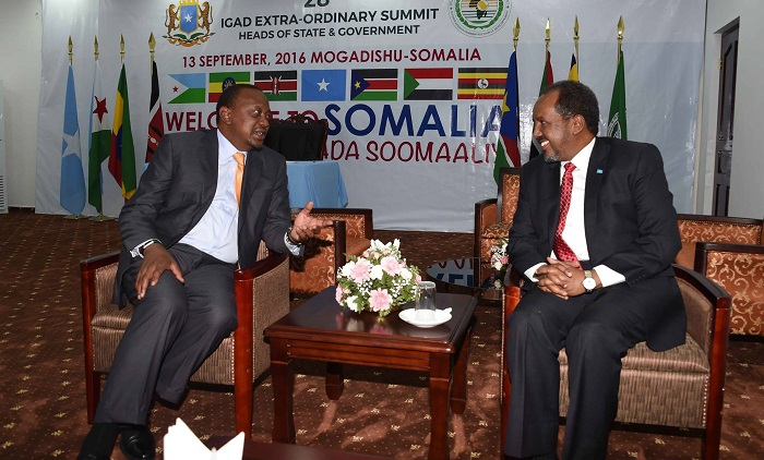 Kenya's Kenyatta and Somalia's  Hassan Sheikh Mohamoud  at an IGAD summit last week. Their oil spat been taken to The Hague.
