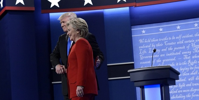 Republican presidential nominee Donald Trump(L) shakes hands with Democratic presidential nominee Hillary Clinton at the start of the first presidential debate at Hofstra University in Hempstead, New York on September 26, 2016. / AFP PHOTO / MANDEL NGAN