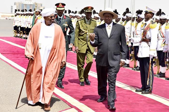 Bashir and Museveni soon after he arrived in Khartoum. PHOTO PPU